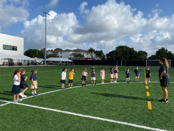 image of lower school student in physical education class on ram field