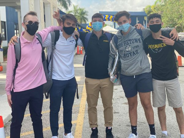 image of five masked male fischer high school students with their arms around each other