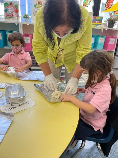 photo of teacher and student baking challah